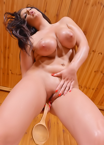 MILF brunette Anissa Jolie plays with her huge tits at the sauna